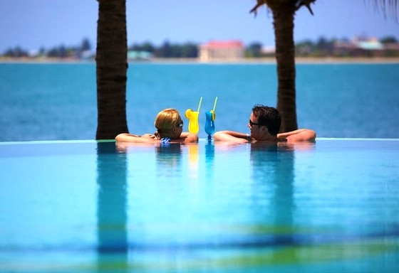 Chabil Mar Belize Resort Couple at Infinity Pool Drinks